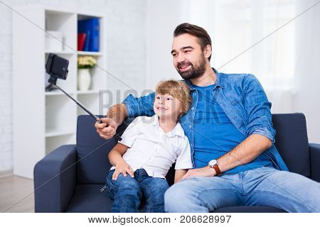 Family Concept - Young Father And His Little Son Taking Selfie Photo