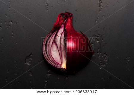 Pieces Of Red Onion In Close Up. Onion Halves
