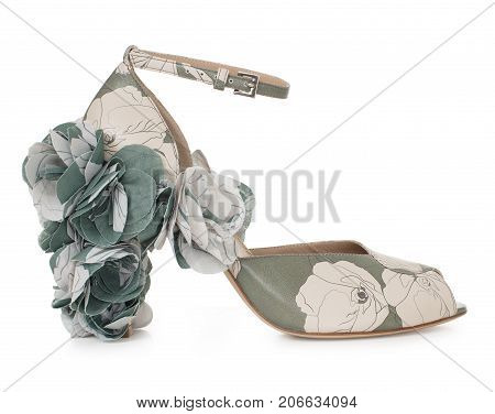Beautiful female luxurious leather shoe of gentle color, high-heeled, with a décor of fabric and leather, on a white background, side view