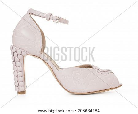 Beautiful female luxury leather shoes of pink, high-heeled, with décor, on white background, side view