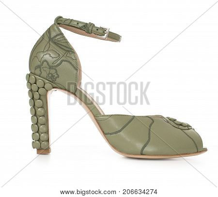 Beautiful female luxury leather shoes of olive, high-heeled, with décor, on white background, side view