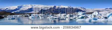 Panoramic view of floating icebergs in the glacial lake Jokulsarlon in Iceland