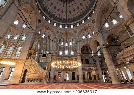Istanbul, Turkey - April 24, 2017: Interior of Eyup Sultan Mosque situated in the Eyup district of Istanbul Turkey outside the city walls near the Golden Horn. The present building dates from the beginning of the 19th