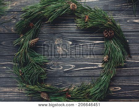Christmas Rustic Wreath And Tree Branches With Pine Cones And Anise On Rustic Background Top View, S
