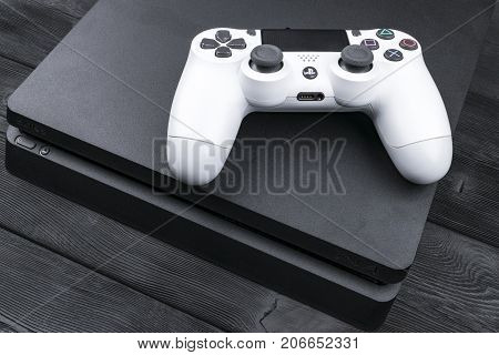 Sankt-Petersburg Russia September 24 2017: Sony PlayStation 4 Slim 1Tb revision and dualshock game controller. Game console with a joystick. Home video game console.