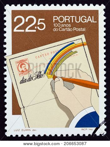 PORTUGAL - CIRCA 1986: A stamp printed in Portugal issued for the 100th anniversary of the first Portuguese postcard shows postcard, circa 1986.