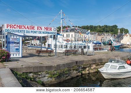 HONFLEUR FRANCE - AUGUST 24 2017: Harbor of historic city Honfleur with landing-stage of launch to Pont de Normandie