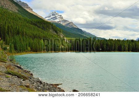 Beautiful High Mountains Of The Canadian Rockies And An Alpine River Along The Icefields Parkway Bet