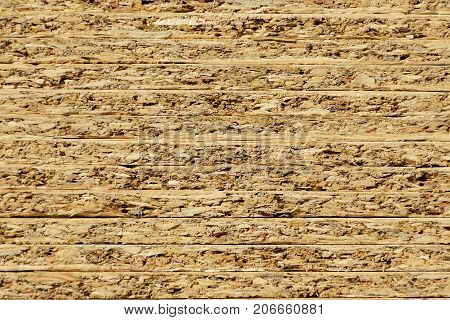 Profile Of The Flake Board A Stacked. Wooden Sawdust Background.