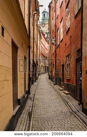 Narrow street between homes in the old town of Gamla Stan in Stockholm, Sweden