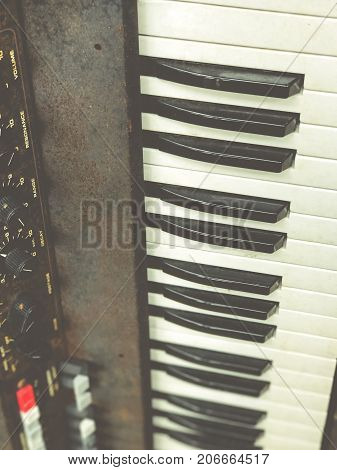 Old retro unnecessary faulty musical synthesizer, equipment controller. Installation Krakow, Poland