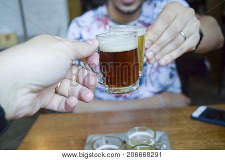 Two Men Toasting (cheers!) Over Mini Beer