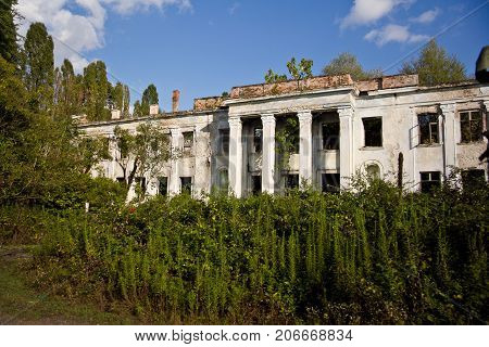 Abandoned and overgrown ruins of school named after Beria. Abkhazia, Georgia