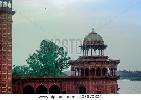 The mosque in front of the Taj Mahal. The Jama Masjid mosque is a sandstone fort with mughal architecture with arched doorways and domes