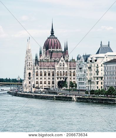 Hungarian parliament building also known as the Parliament of Budapest Hungary. Danube river. Travel destination. Photo filter. Architectural theme.
