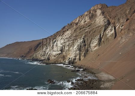 Anzota Caves at Arica on the coast of Chile. The area was used as a settlement by the Chinchorro people and later mined for guano deposited on the cliffs.
