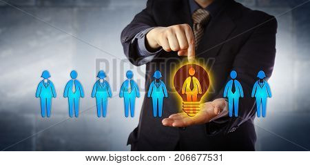 Unrecognizable manager appointing the ideal candidate from a lineup of four male and four female workers. Business concept for talent acquisition coaching promotion and performance evaluation.