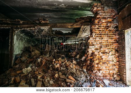 Inside ruined abandoned house building after disaster, war, earthquake, Hurricane or other natural cataclysm