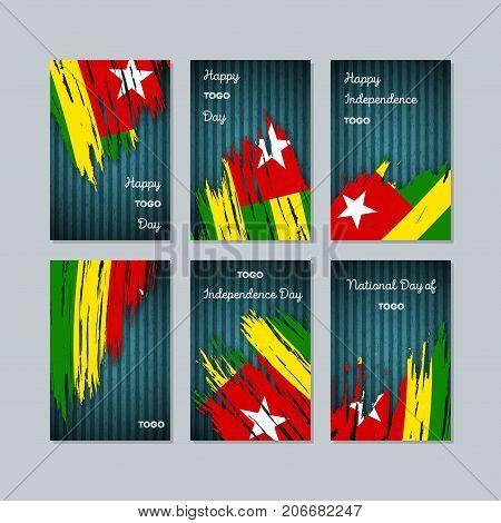 Togo Patriotic Cards For National Day. Expressive Brush Stroke In National Flag Colors On Dark Strip