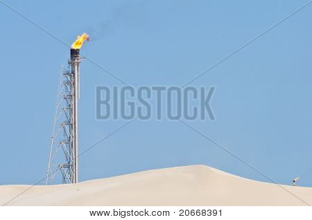 Flaming Candle In The Desert