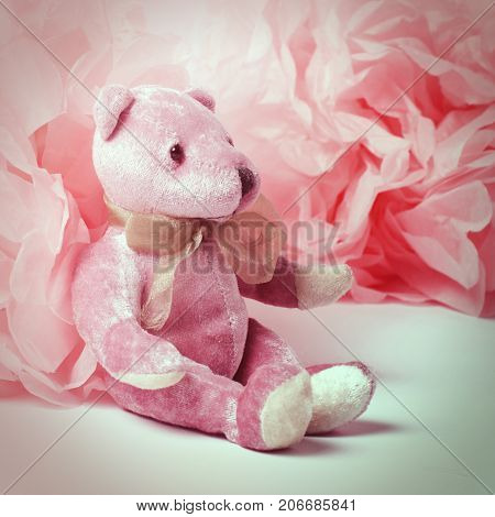 Hipster style background with a pink plush bear.