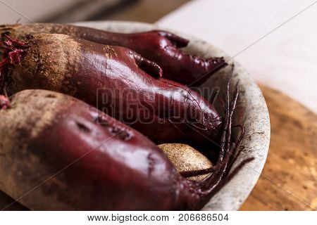 Fresh beetroot in metal ware on a light background.