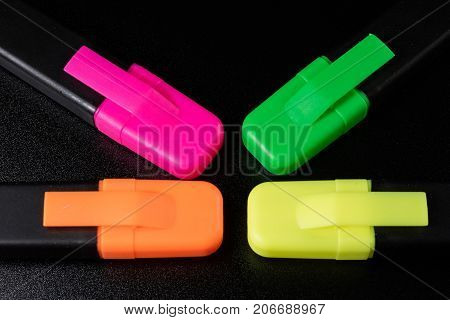 Office Highlighter On A Black Background. Office Mazak To Draw Are Lying On A Black Countertop.