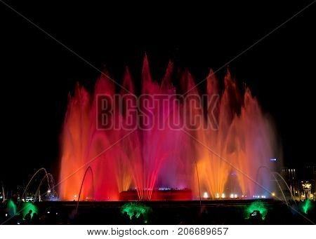 A water fountain show at night in Barcelona