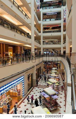 Kuala Lumpur Malaysia: 26 July 2017 - View of shops café and people inside multistorey shopping mall at Suria KLCC the premier shopping desination in Kuala Lumpur Malaysia.