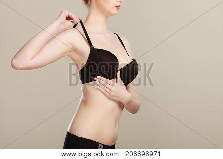 Girl Getting Comfortable In Her Bra