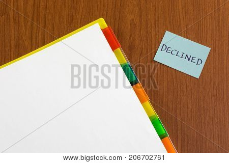 Declined; White Blank Documents With Small Message Card.