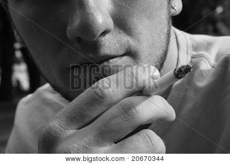 Caucasian man holding a cigar