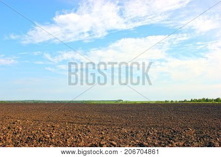 agricultural field, which was plowed for sowing crops. Spring