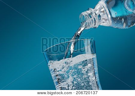 Pouring Fresh Water Into A Glass