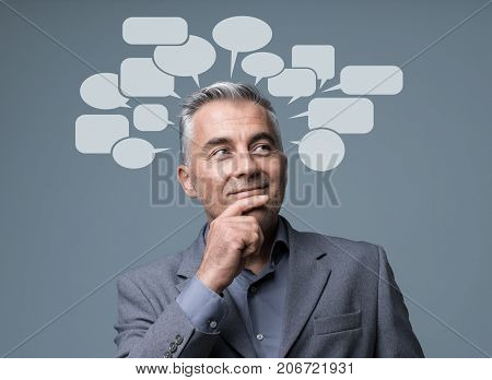 Creative Smart Businessman With Speech Bubbles
