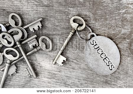 old key with success written on a ring