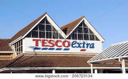 Llanelli, UK: January 25, 2016: Front view of a Tesco Extra Superstore in Wales. Tesco PLC is a British multinational grocery and general merchandise retailer.