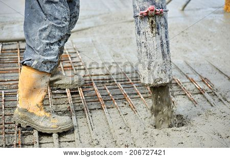 construction site pouring concrete by hard worker
