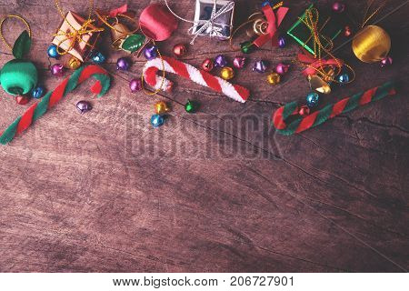Christmas and new year wooden background banner with gift box candy ball and ribon decoration on vintage background.