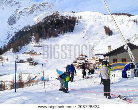 Courmayeur, Italy - January 27, 2015: Winter ski resort in Italian Alps. Mountains, ski lifts and people