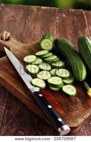 Fresh And Sliced Cucumbers. Sliced Cucumbers On A Cutting Board.