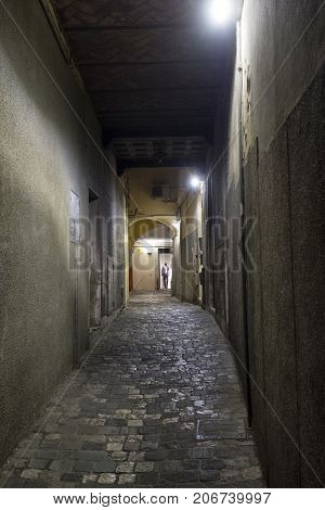 Cesena (Emilia Romagna Italy): old street at evening