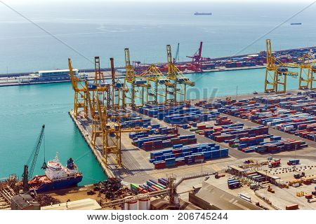 BARCELONA SPAIN - AUGUST 21 2012: Terminal Port Nou Industrial Port for freight transport ship in import export and business logistic By crane Trade Port Ship cargo to harbor Barcelona. Catalonia Spain.