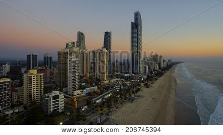 GOLD COAST, AUSTRALIA - SEPTEMBER 3 2017:  Aerial view of Surfers Paradise and city centre at first light, with night lights on the Esplande.