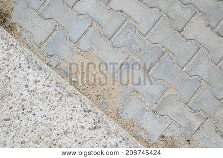 Joint of Concrete and Paving Stones from the Sidewalk. Paving stones on a footpath
