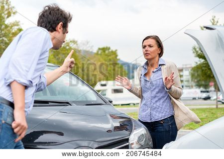 Woman Driver And Man Arguing About The Damage Of The Car After Accident