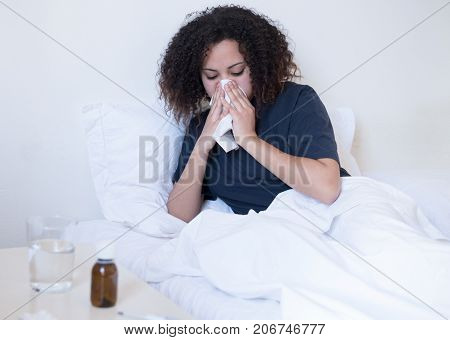 Sick Black Woman Lying In The Bed