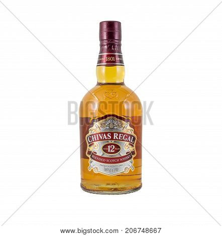 Ternopil Ukraine - August 26 2017: Bottle of Blended scotch whisky Chivas Regal. 12 years old scotch whiskey. Made in Scotland. Bottle of whisky isolated on white.