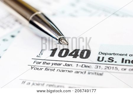 Pen on tax form 1040. Close up.