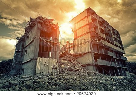 Post apocalyptic destroyed concrete building in city